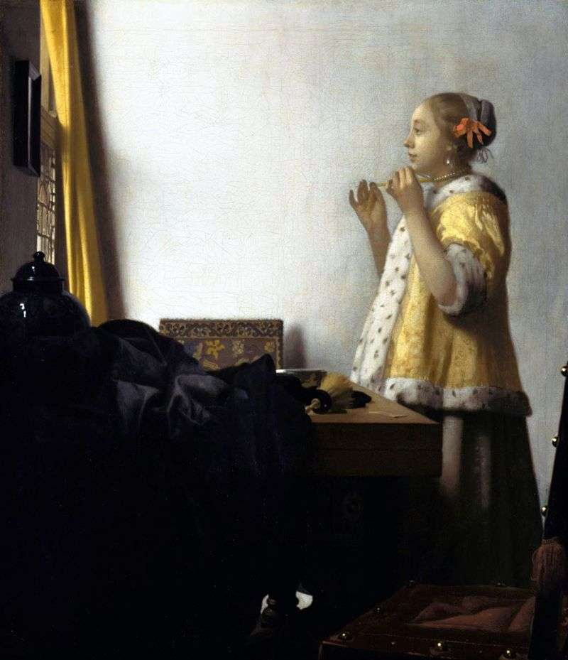 A girl trying on a necklace by Jan Vermeer
